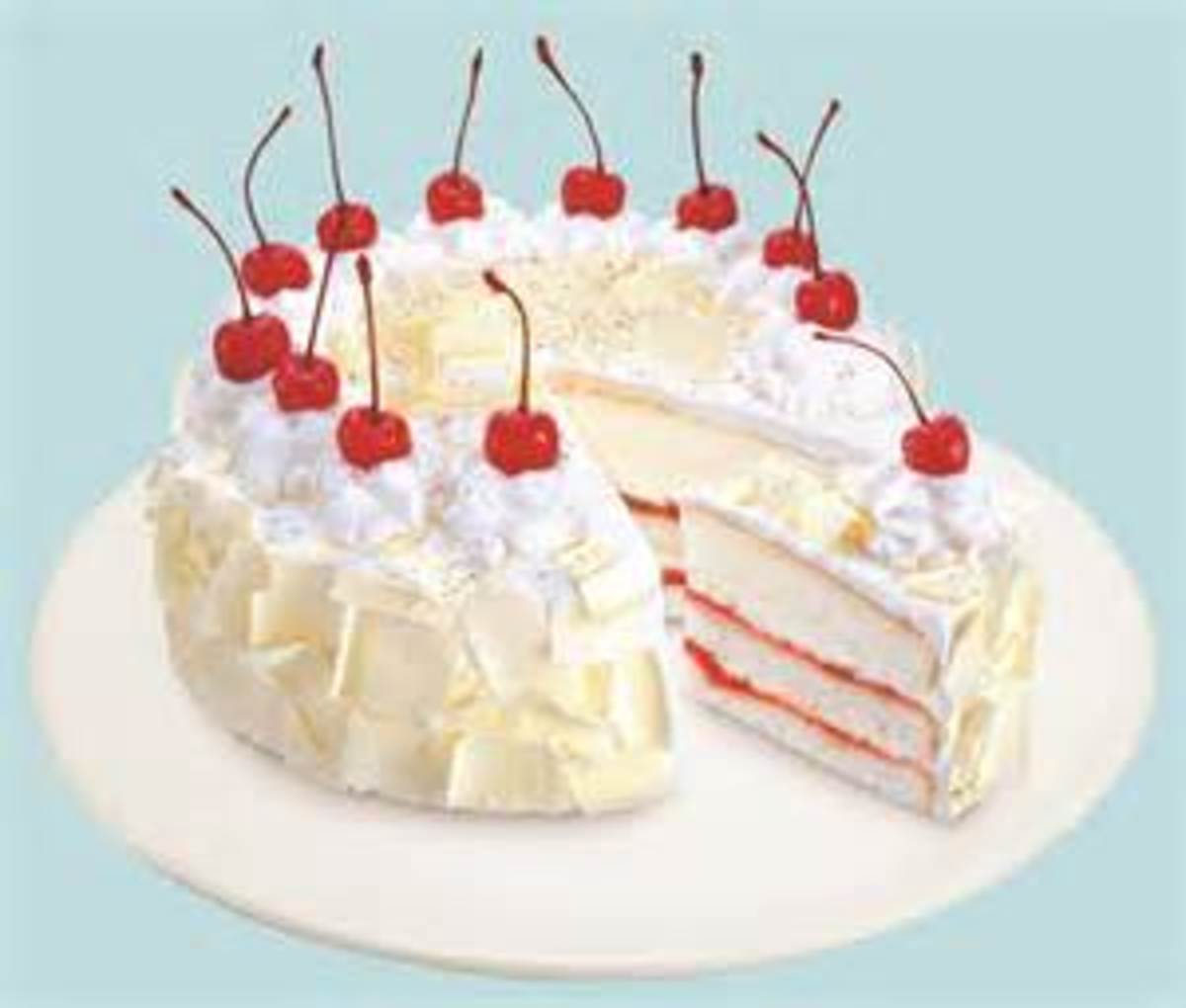 White cake with Cherry filling and topped with cherries