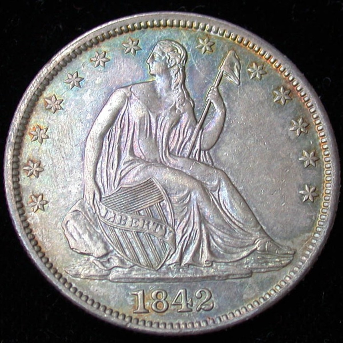 1842 Seated Liberty Half Dollar Medium Date. Photo Courtesy: coinpage.com