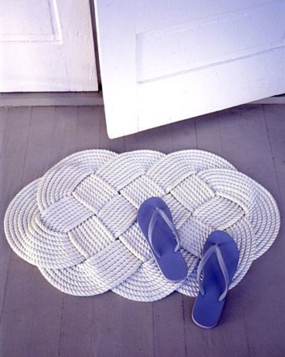 Braided doormat made from rope. Click the links below for instructions to Martha's rope crafts. Source:  MarthaStewart.com.