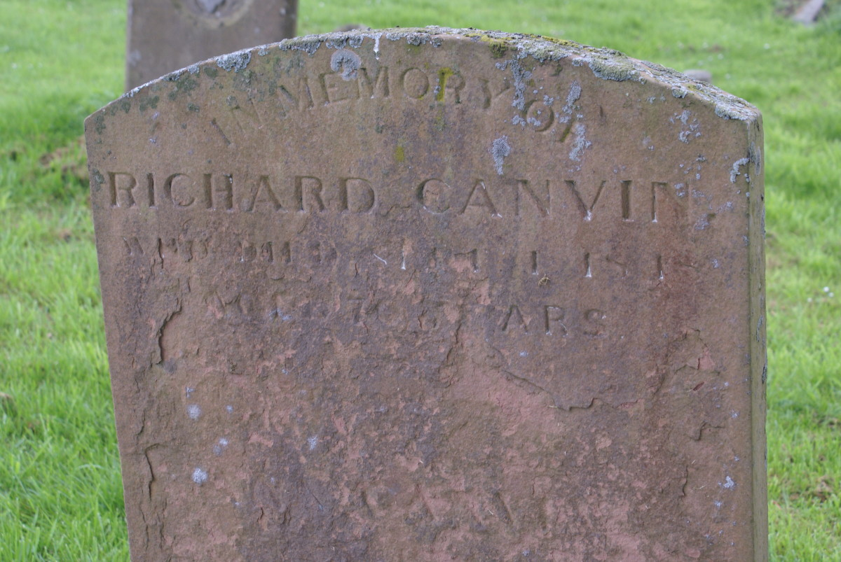 Close up of gravestone, believe it to read that he died sometime in the 1800s and that he was 70 years of age at the time of his death.