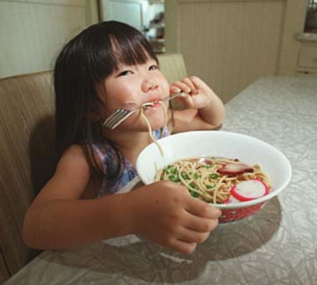 Child eating saimin