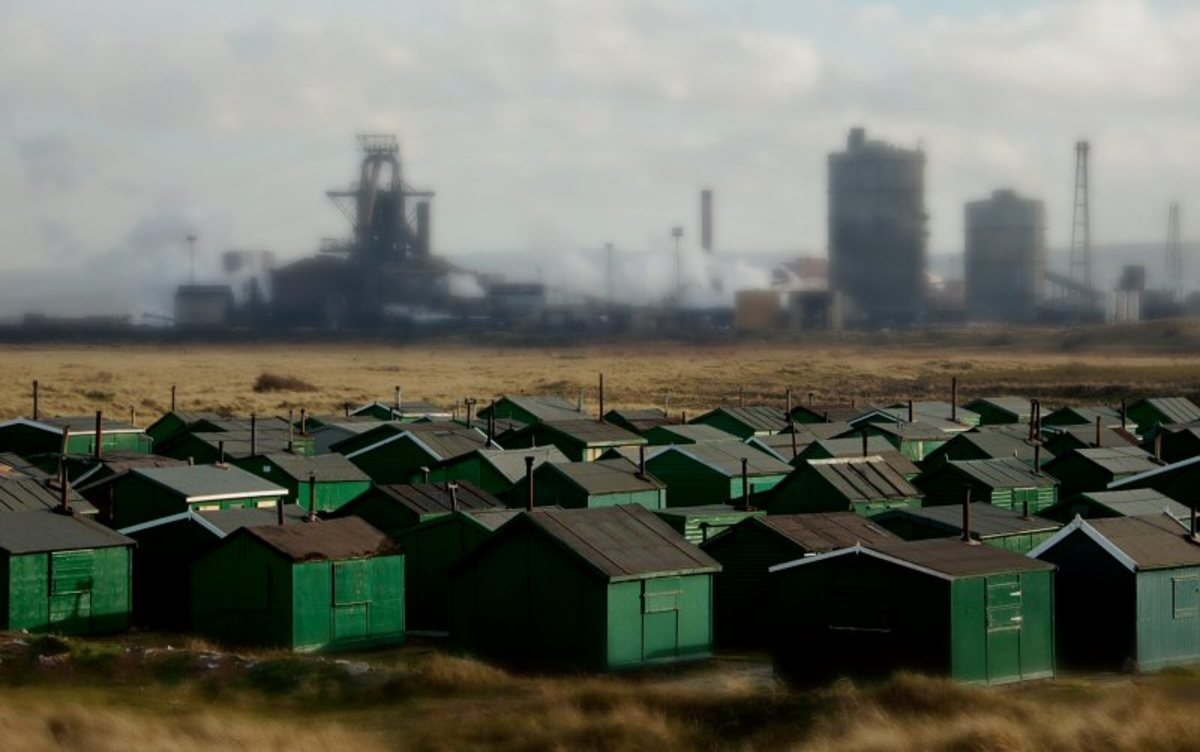 Fishermen's huts set against the backdrop of   the now defunct Warrenby steel works