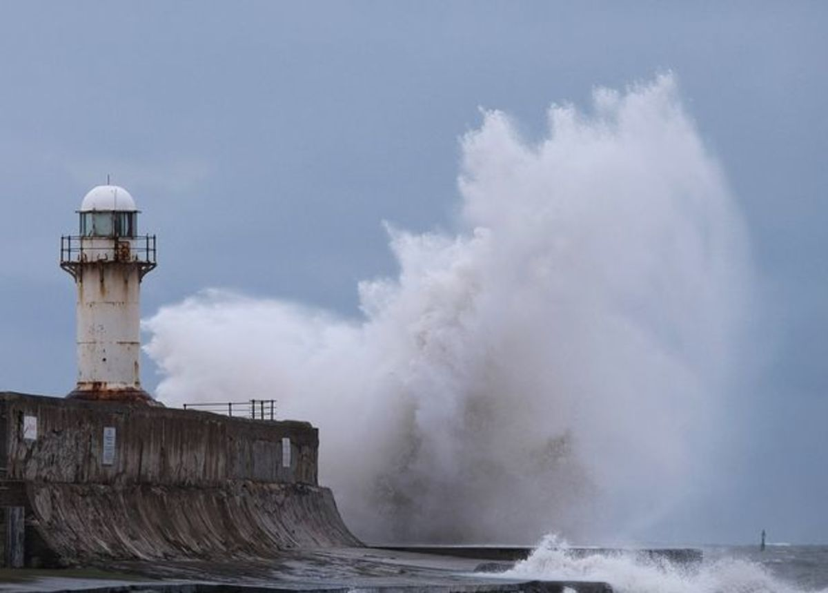 Winter weather in the Tees Bay - storm wave surges over the South Gare beacon in the recent past