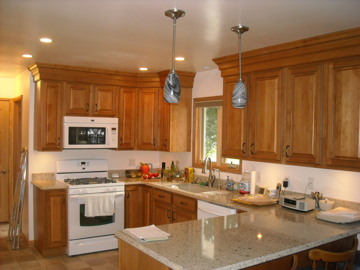 This kitchen that I remodeled was missing something.  Adding decorative moldings to the top of the cabinets finishes the look and makes the cabinets look taller.