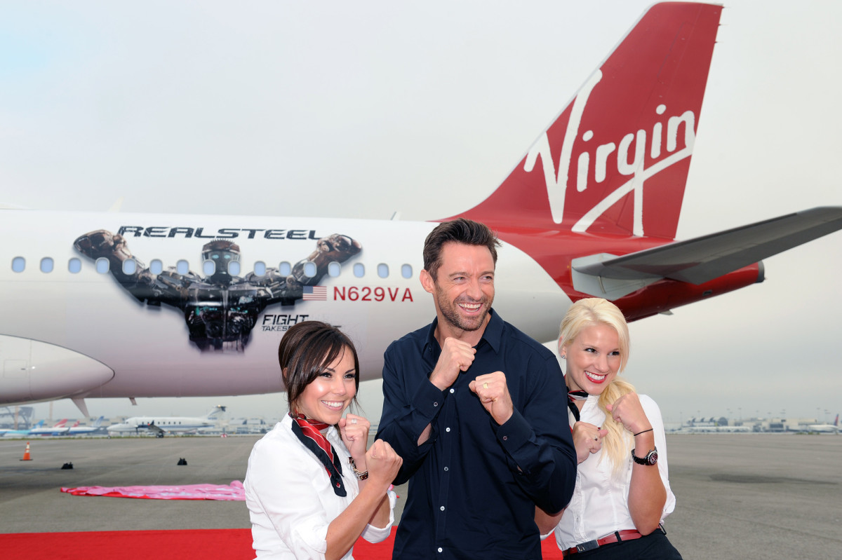 Hugh Jackman and stewardesses launching a new jet with Atom. © Virgin Atlantic Airline