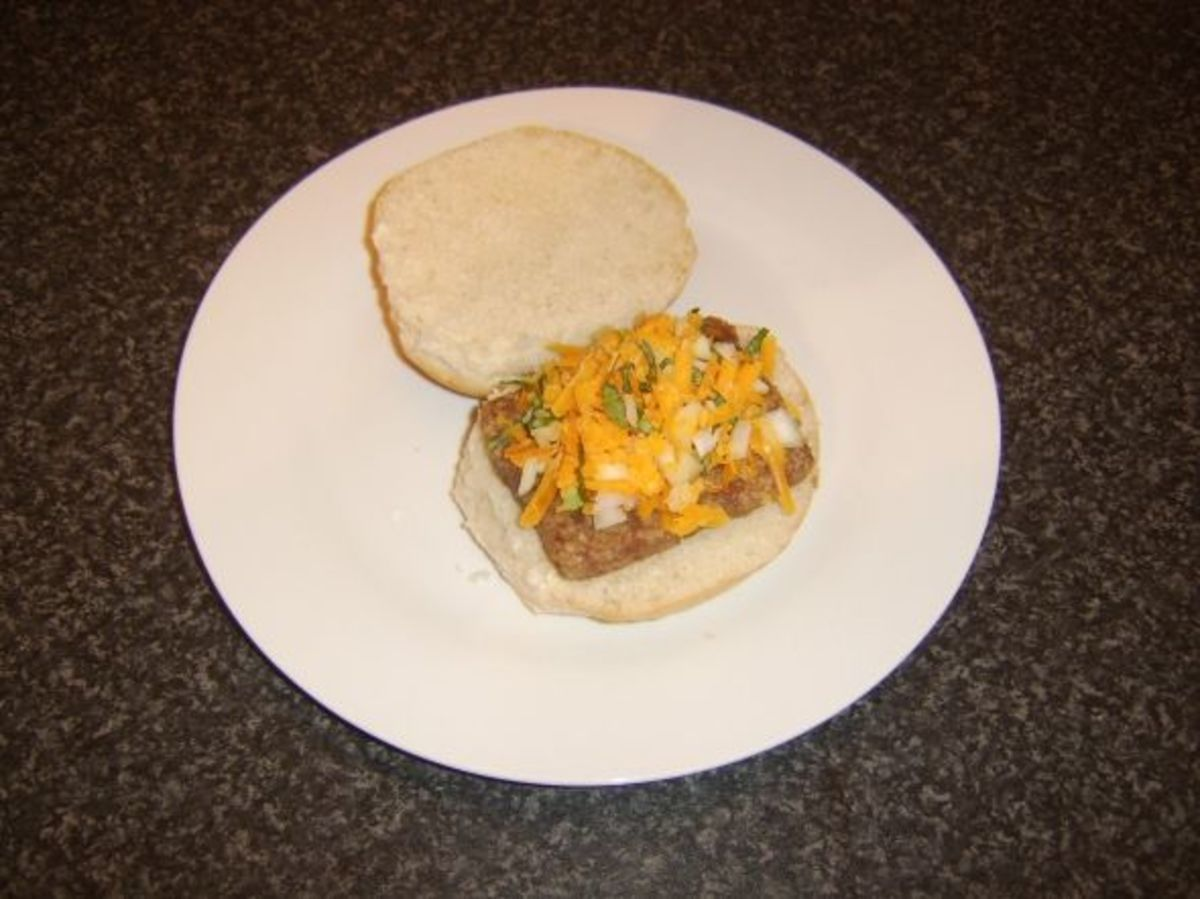 Roll and sausage with grated cheese, onion and basil