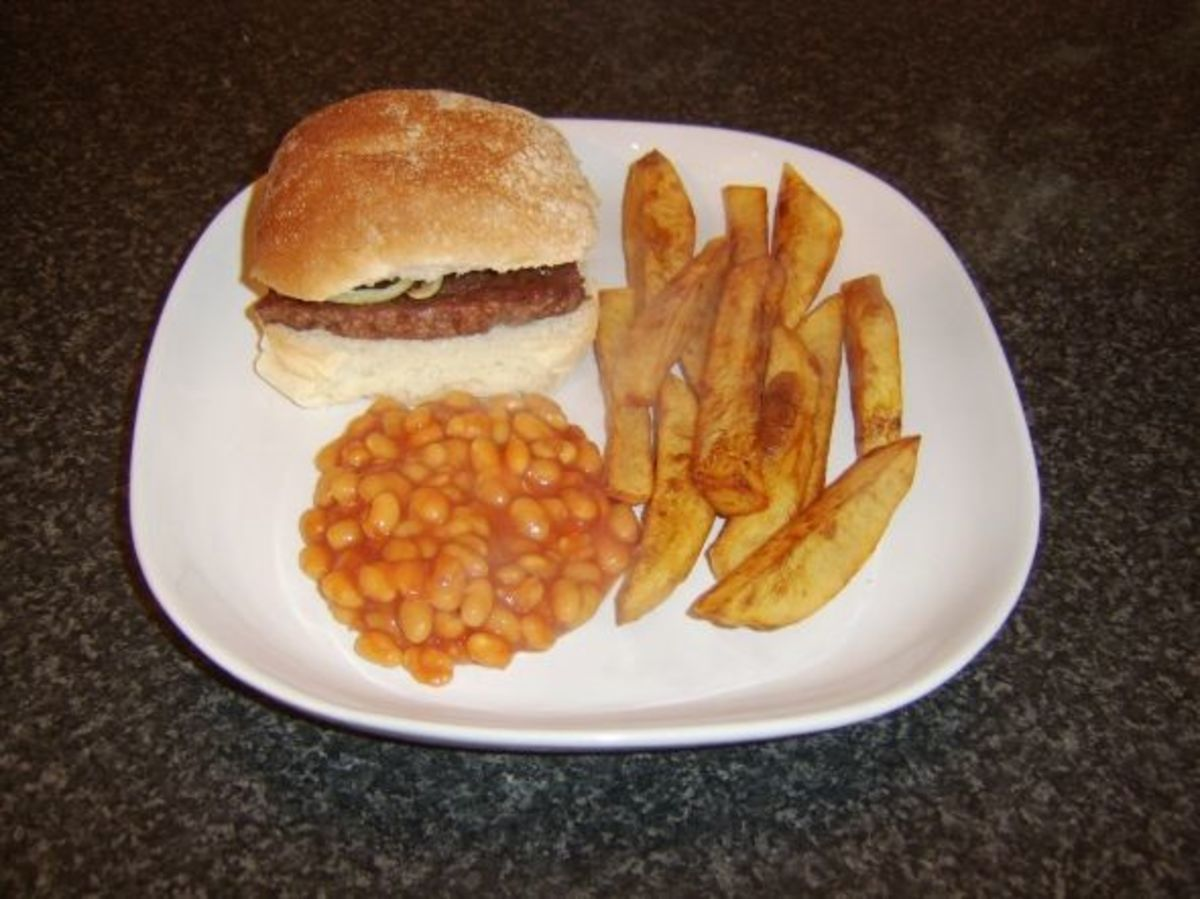 Roll and sausage with chips and beans