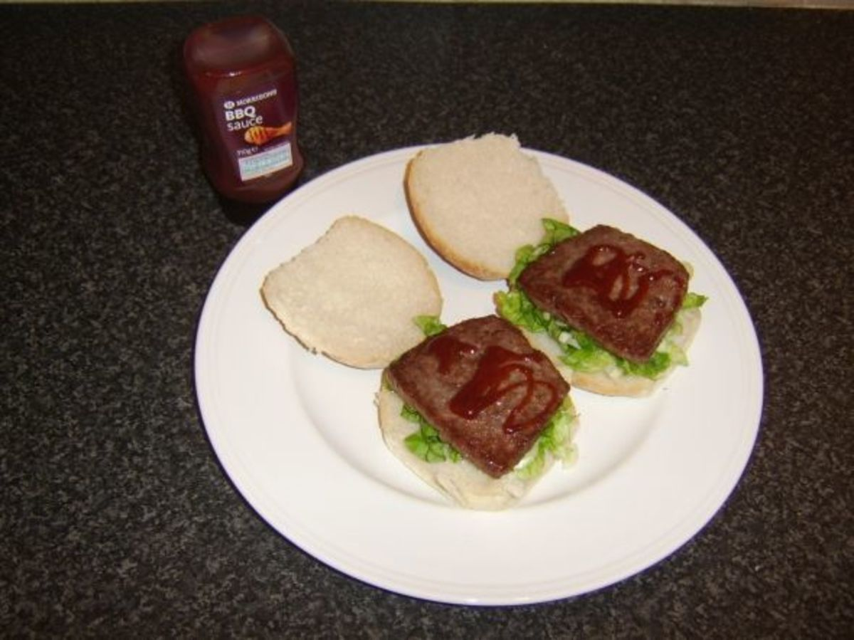 Roll and sausage and salad with BBQ sauce