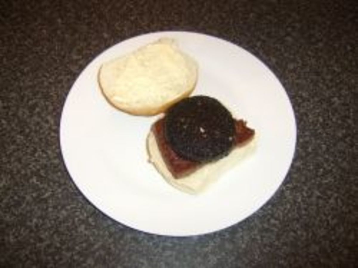 A roll and sausage and black pudding