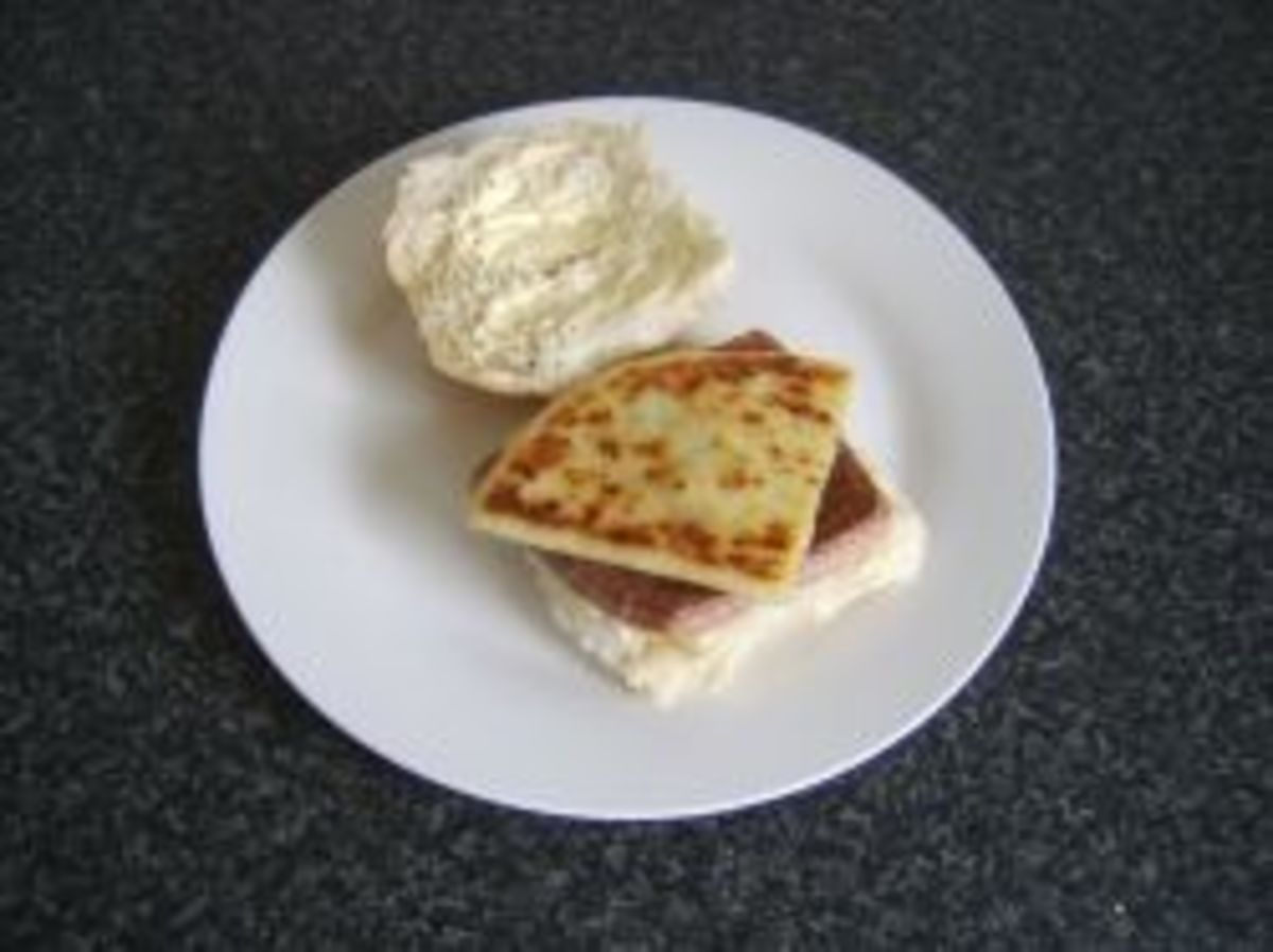 Tattie scone is added to a roll and sausage