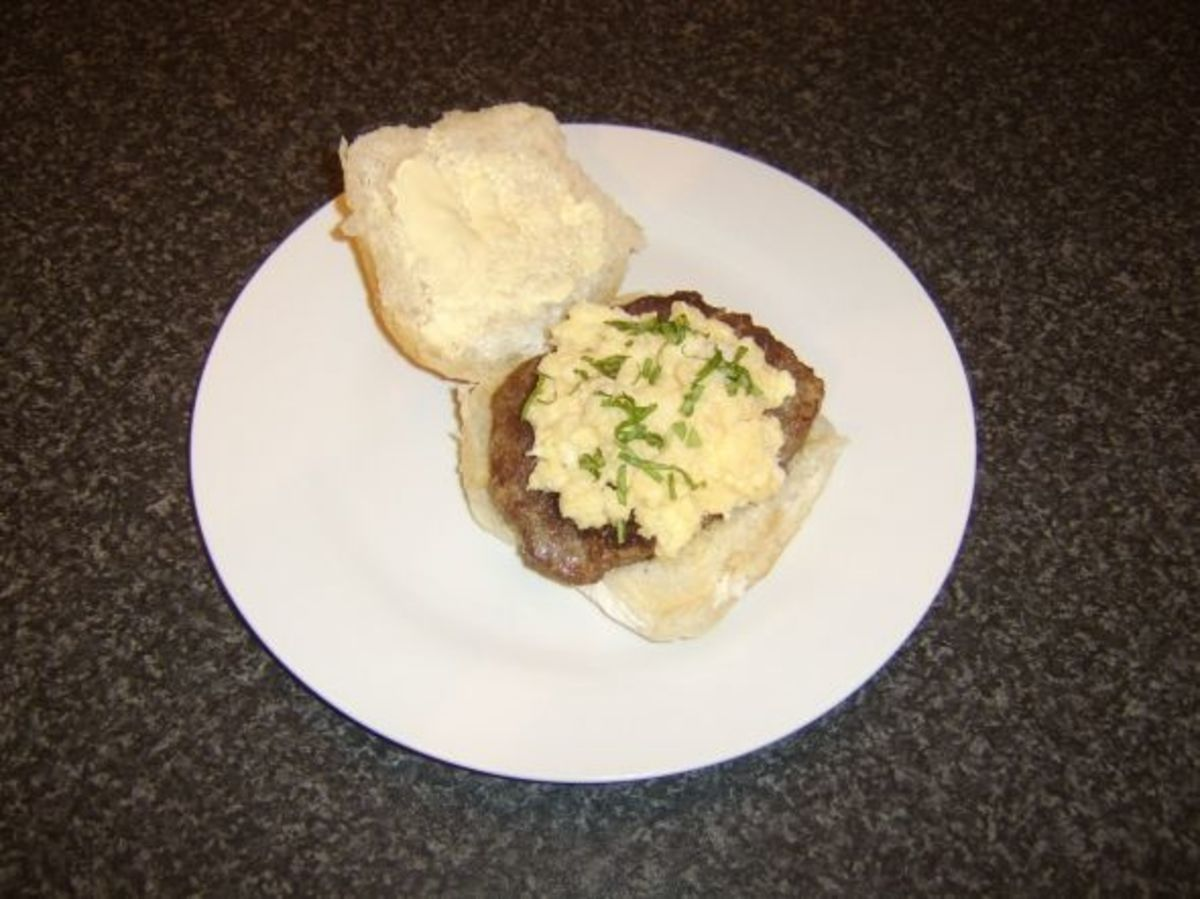 Roll and sausage and scrambled duck egg