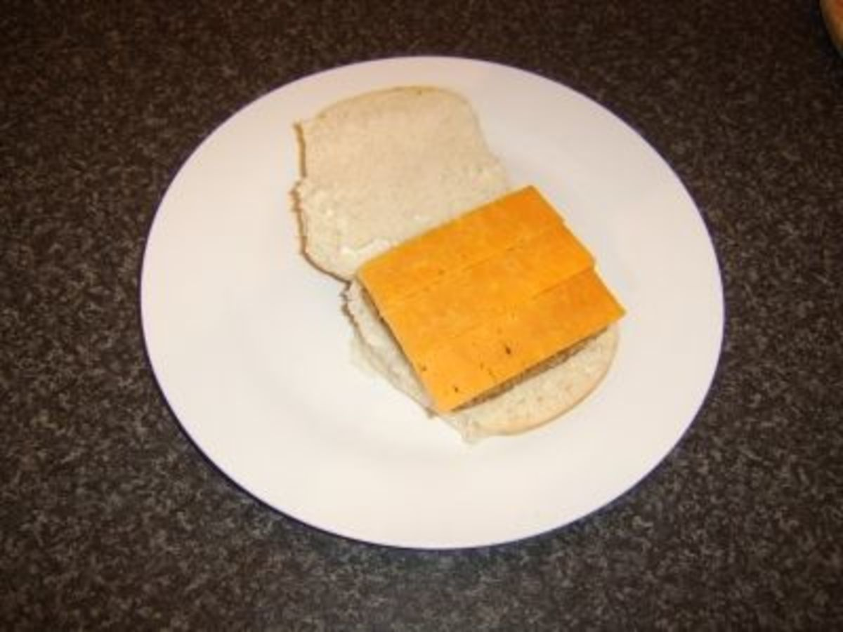 Scottish cheddar cheese ready to be melted on a Lorne sausage
