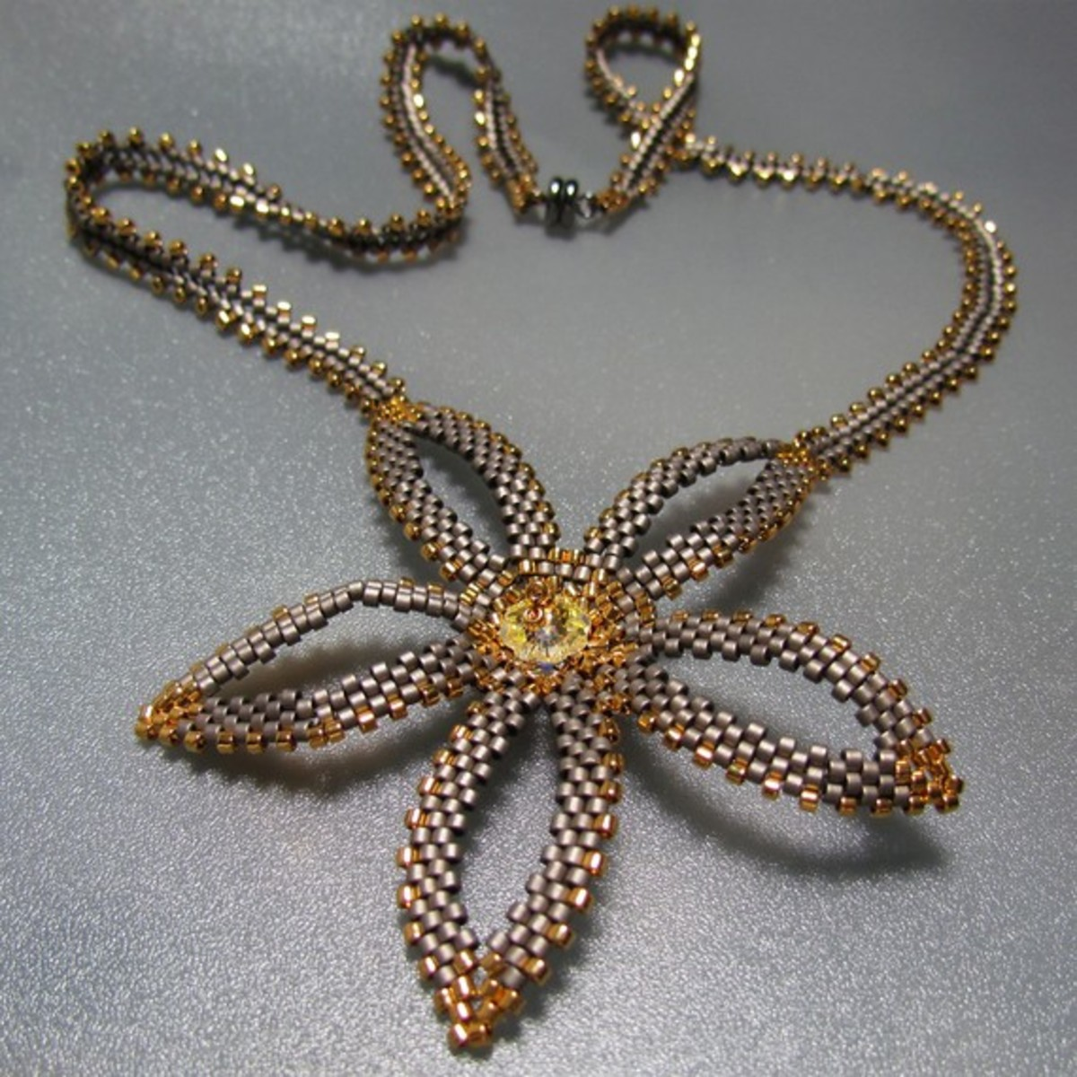 Snowdrop Necklace: This necklace combines a peyote flower with a herringbone rope.