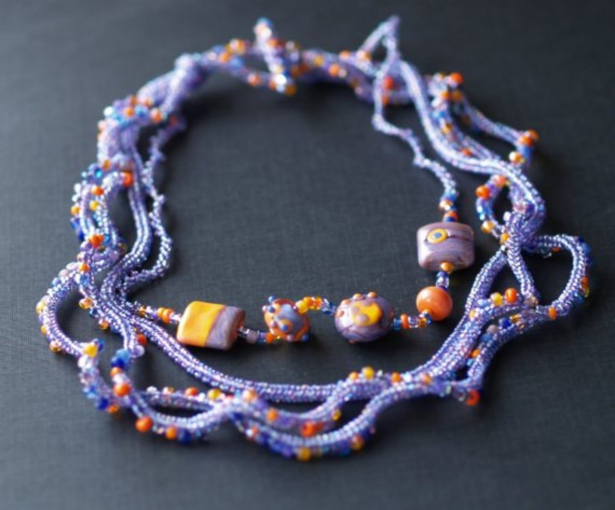 Over the Moon Necklace: MaryLou uses different sized seed beads as well as lamp work focals to create this stunning necklace.