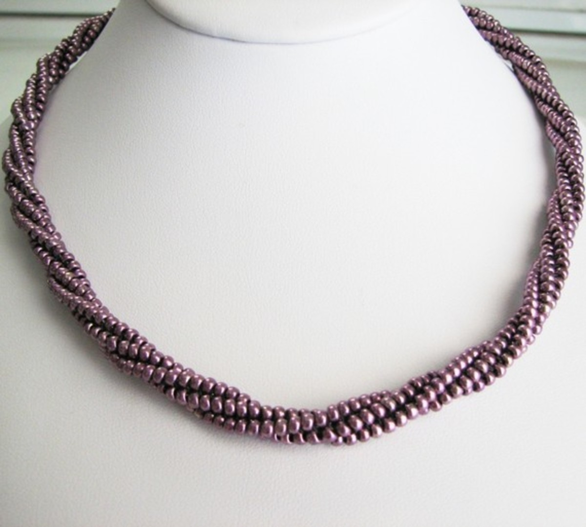 Beaded Rope Wrap in Eggplant: This piece can be wore as a necklace or wrapped as a bracelet.