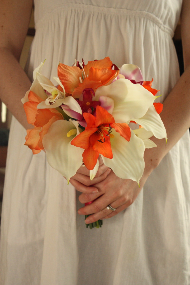 White calla lilies and orange day lilies make a fun tropical bouquet!