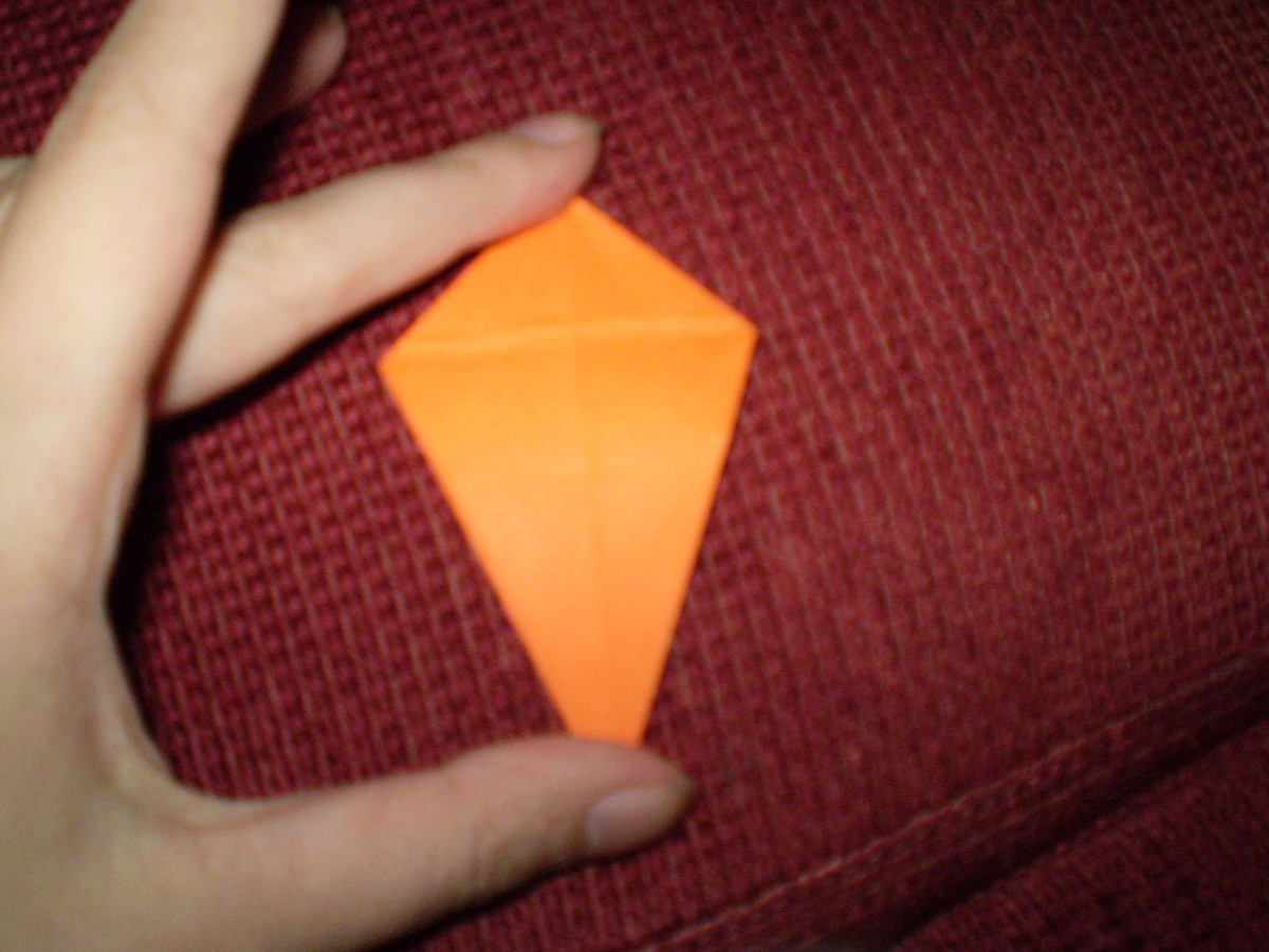 When you've done this on both sides, you will end up with a kite-like model.  Fixate all your folds, and fold back to the structure you had when you started this step.
