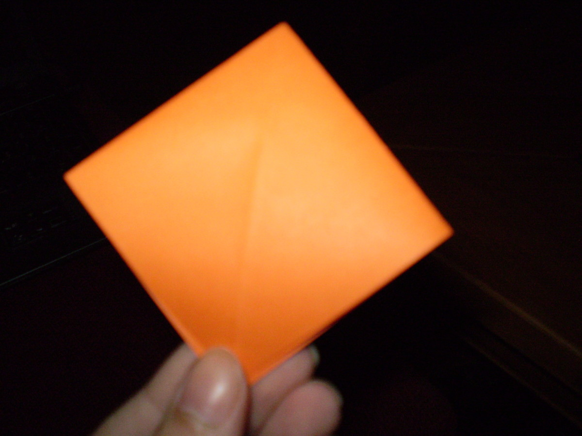 Lastly, fold down the upper layer, to create a square like this.