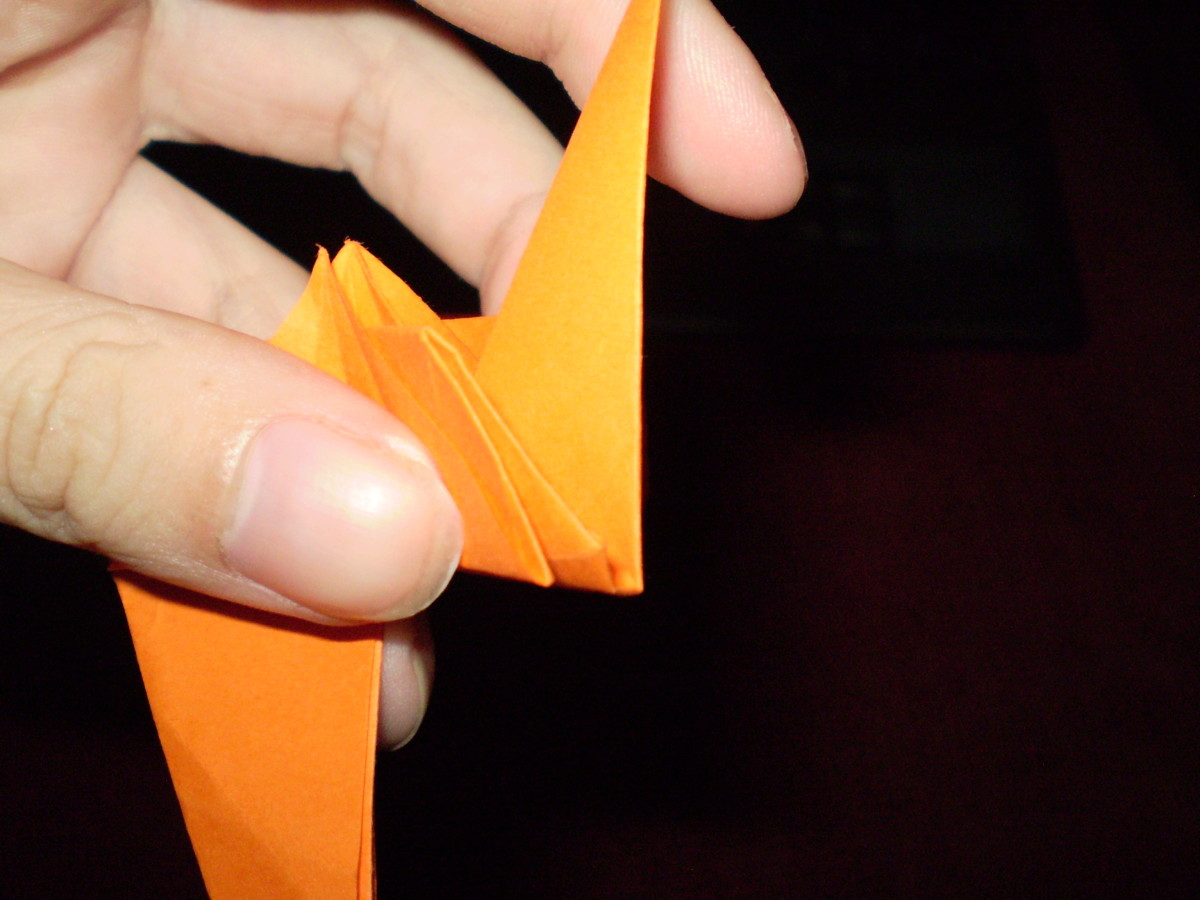 Then, take the lower part of your model's 'leg' and reverse the fold, folding it backwards into itself.