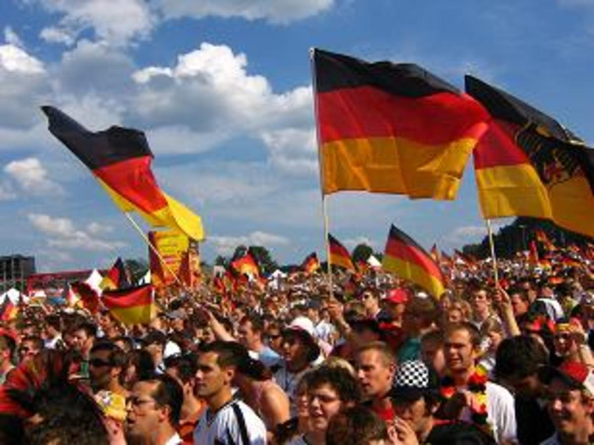 Germanys attitude towards its own identity was shaped by events in the 20th century, such as the two World Wars and German division and reunification, and a new generation of Germans are ready to embrace their national identity.