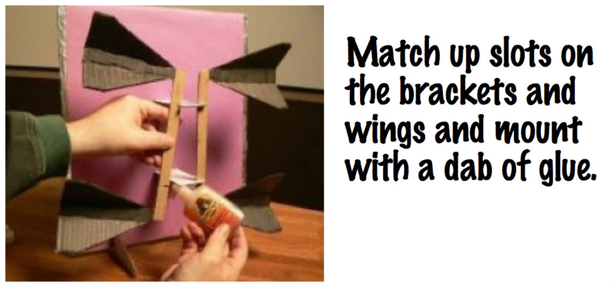 Mount the brackets to the wings, matching up slots, with a dab of glue.