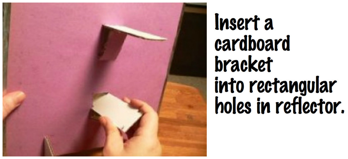 Insert a cardboard bracket into each rectangular hole you have cut into the reflector.