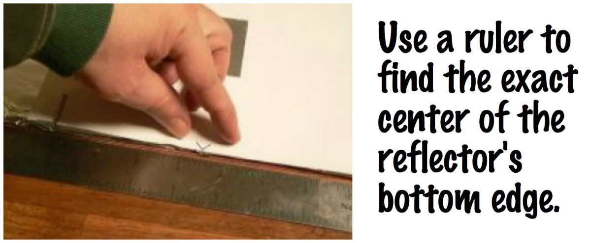 Use a ruler to find the exact center of the reflector's bottom edge.