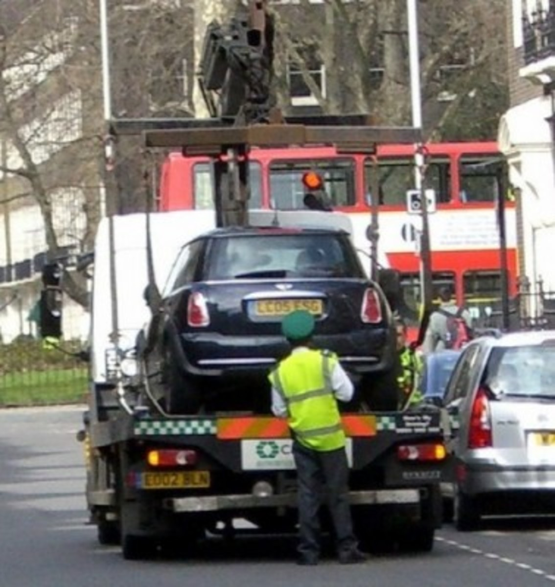 Towing service loading a car on a flatbed tow truck
