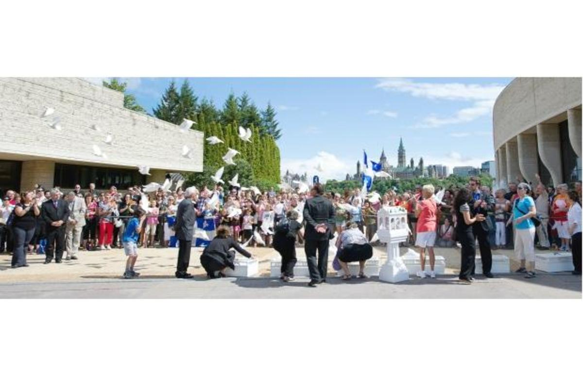 Sixty-one doves are released at the Museum of Civilization in Gatineau on Thursday after the hearse bearing the casket of NDP Leader Jack Layton brought the body of the Quebec-born politician back to his home province one last time.