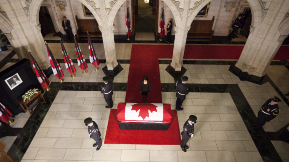 Olivia Chow, wife of NDP Leader Jack Layton, approaches her husband's casket as he lies in state in the foyer of the House of Commons in Ottawa, Wednesday Aug. 24, 2011.