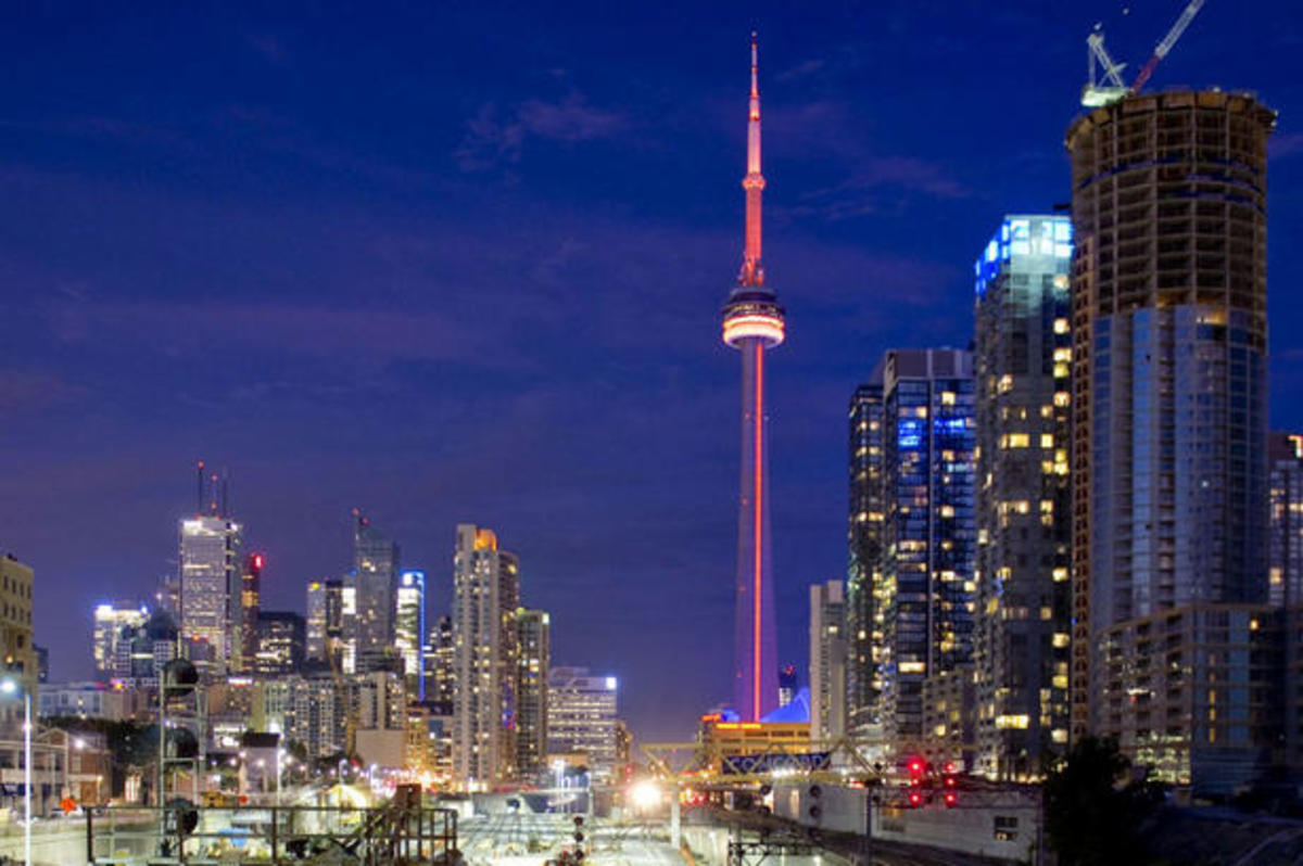 The CN Tower is lit orange from sundown Saturday until sunrise Sunday to commemorate the passing of Jack Layton.