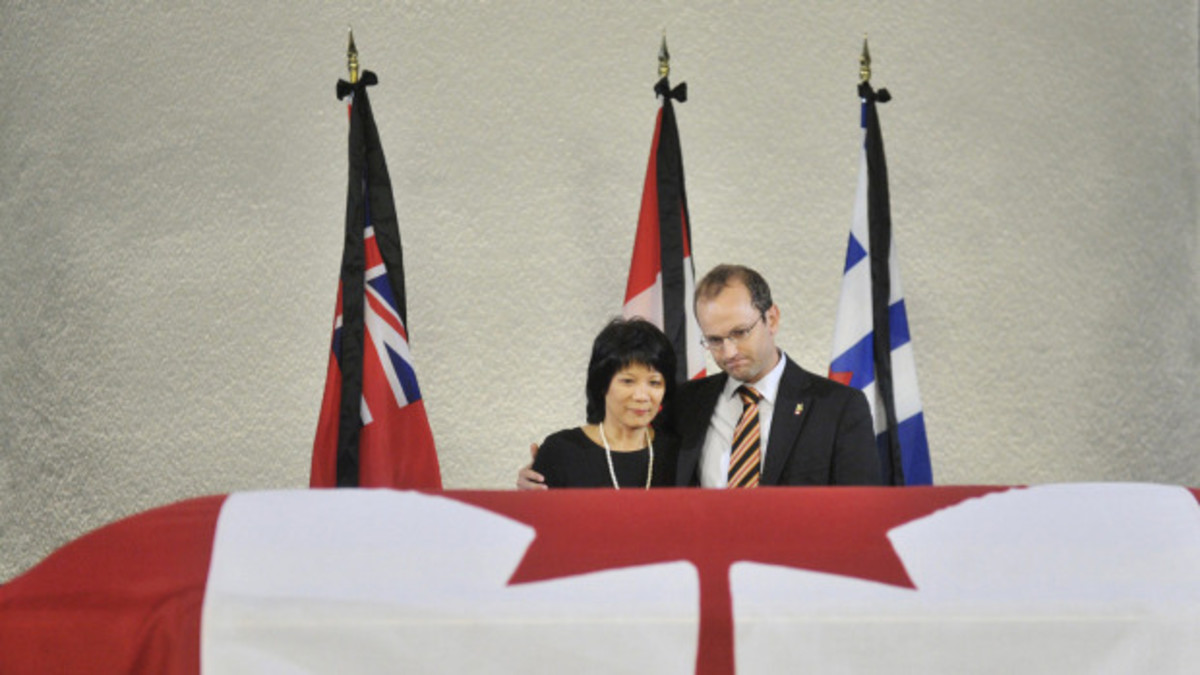 Olivia Chow and Mike Layton stand at the casket of NDP leader Jack Layton, placed to rest in Toronto City Hall in Toronto on Thursday, August 25, 2011.