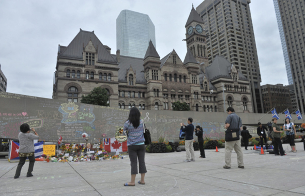 The makeshift wall of memorial outside City Hall, Toronto, August 25, 2011.
