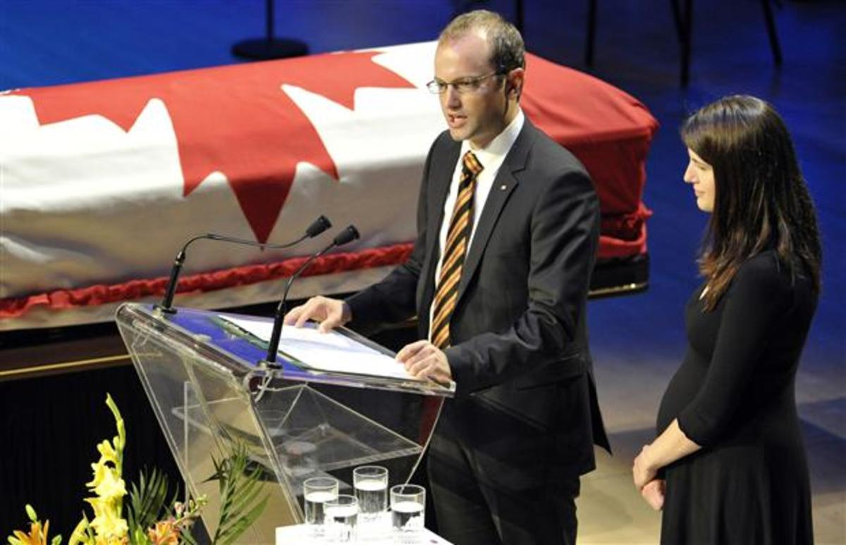 Mike and Sarah Layton, children of NDP Opposition Leader Jack Layton, speak during the state funeral for their father in Toronto August 27, 2011.