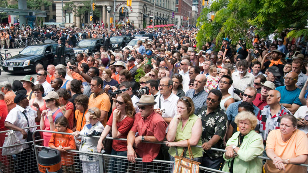 People crowd outside Roy Thomson Hall ahead of funeral services for NDP leader Jack Layton in Toronto on Saturday, Aug. 27, 2011.