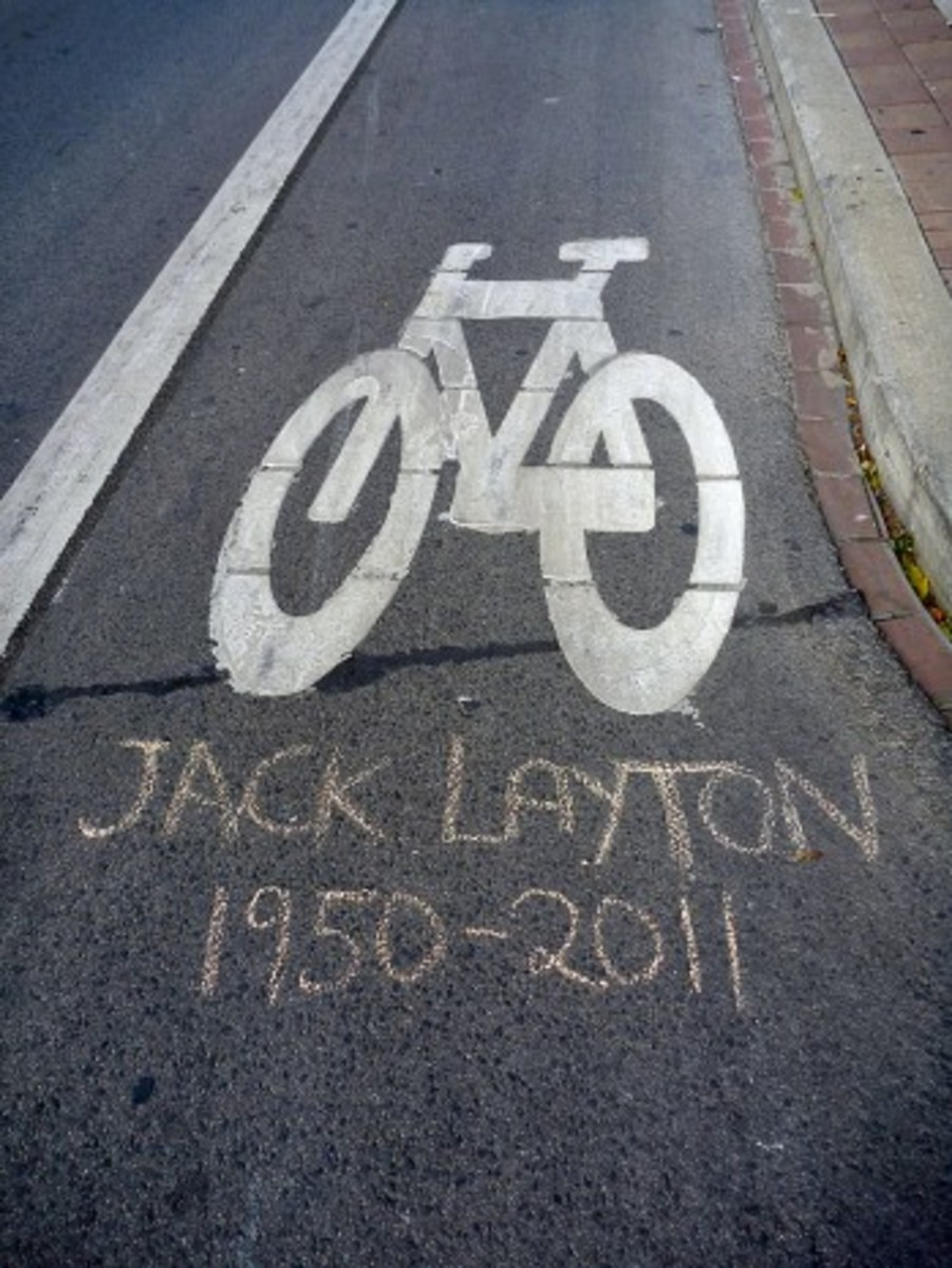 A tribute to Jack Layton written in chalk adorns a Toronto bike lane. As a member of city council, Layton promoted city cycling.