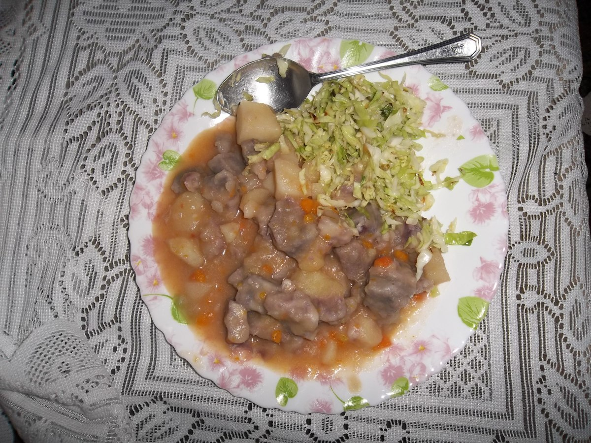 A Nduma dish with potatoes and carrots for additional flavour. Steemed cabbage has been added to balance the diet.