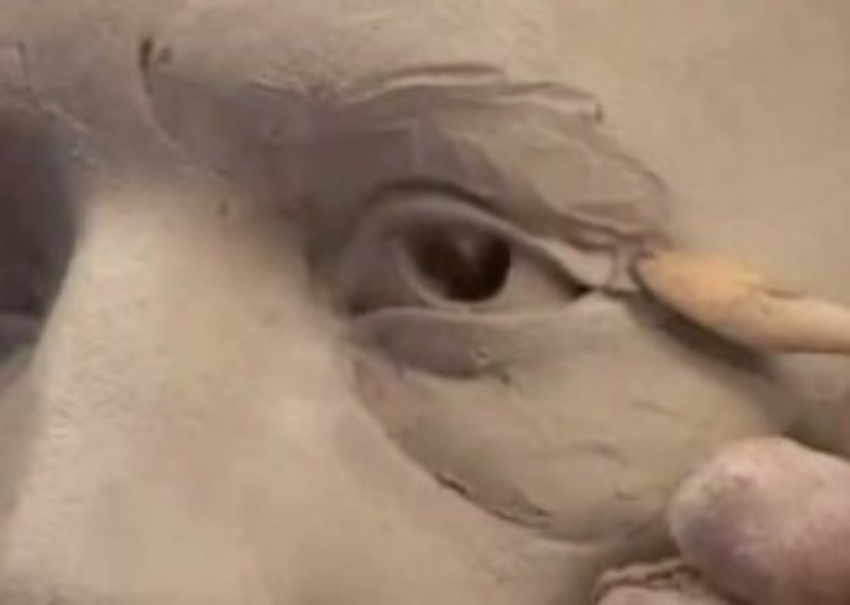 Ceramic sculptor Philippe Farautâs sculpts an old man's eyes