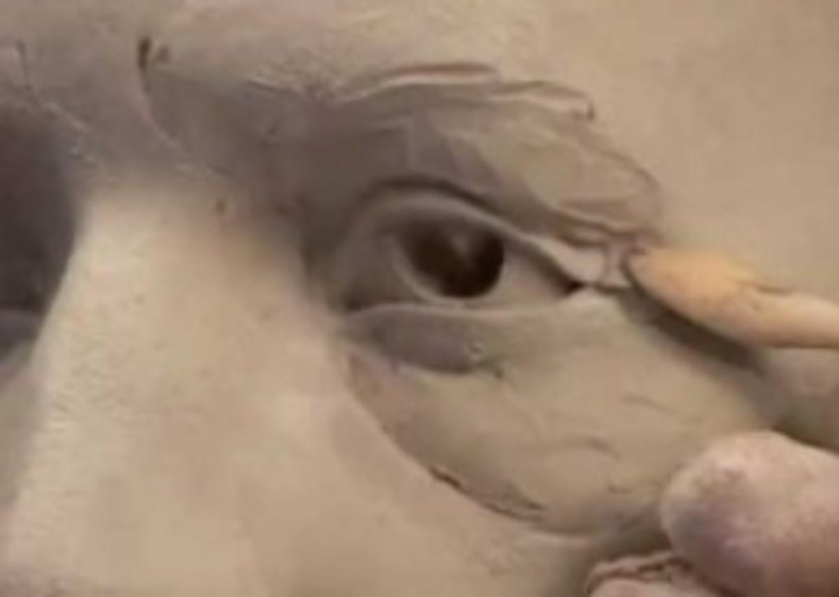 Ceramic sculptor Philippe Farautâs sculpts an old man's eyes