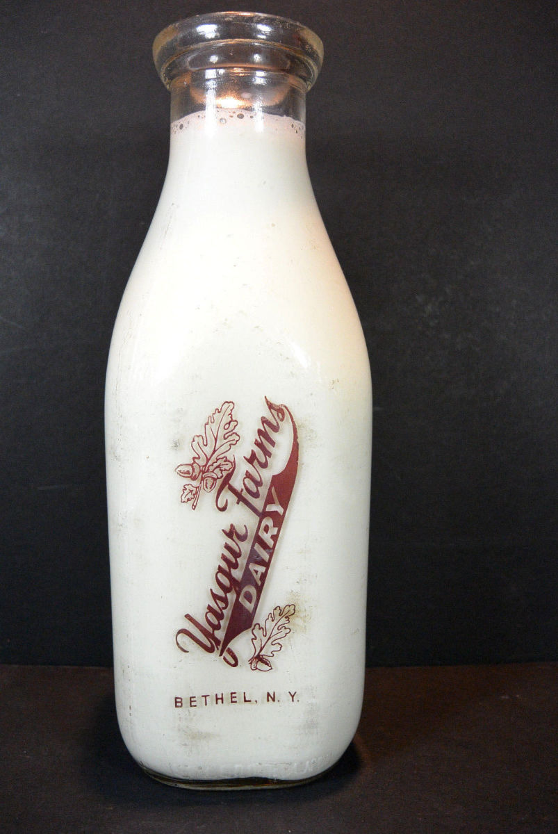 Style and design of the 1960s milk bottle from Max Yasgur's farm.