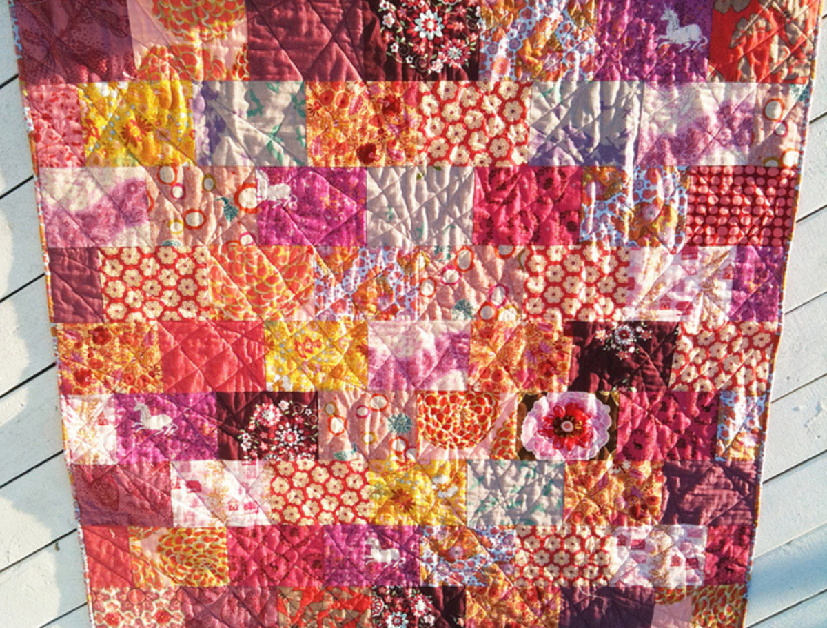 This modern quilt uses modern fabric with bold graphics and colors.