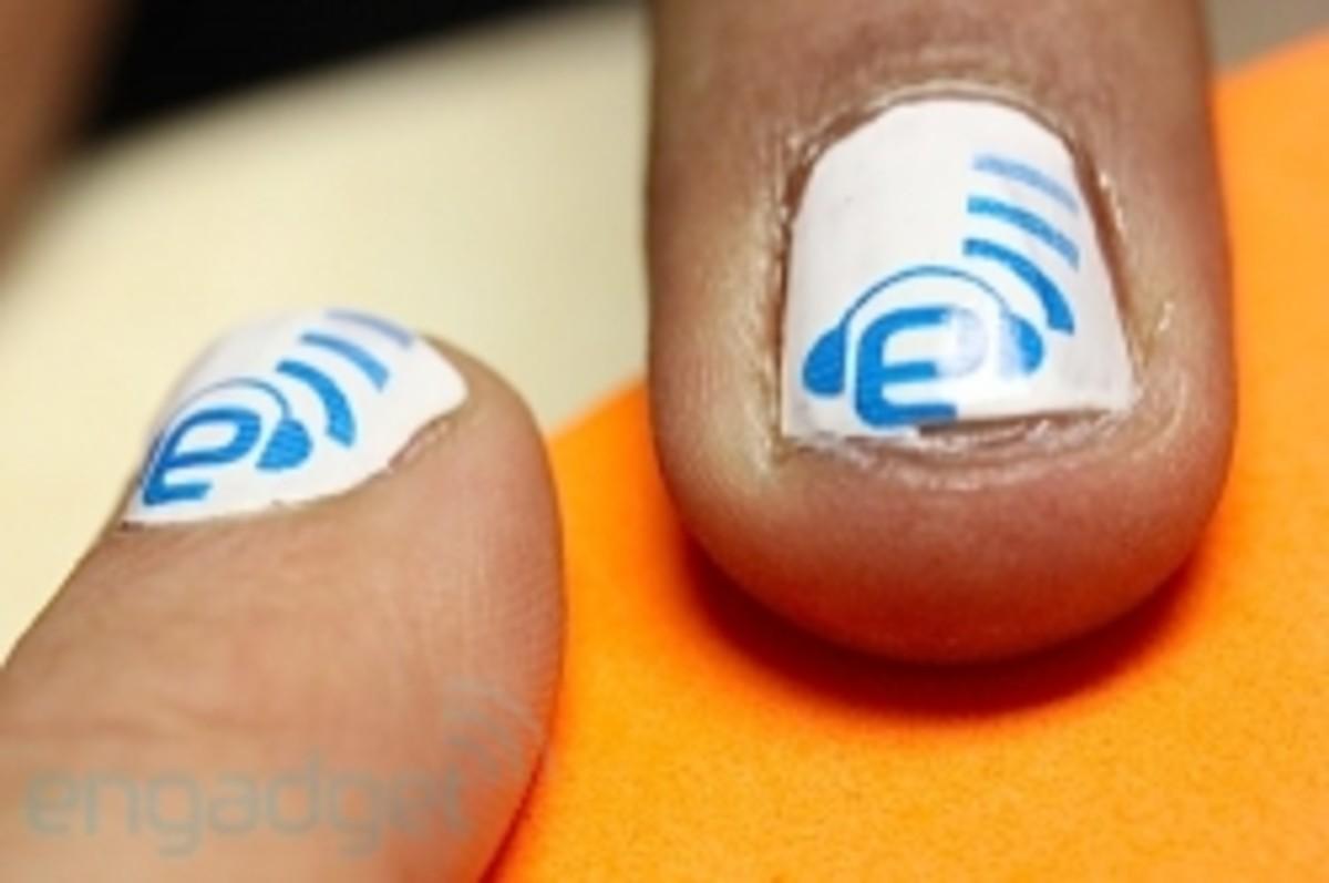 Photo of someone using the nail printer at CES 2011