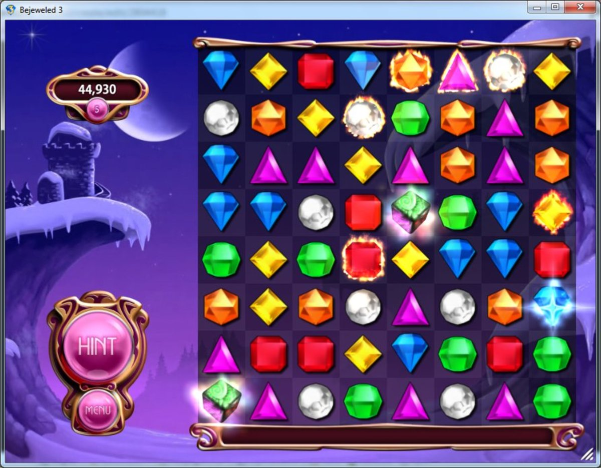 Bejeweled 3 Classic mode showing 2 hypercubes, a star gem and several flame gems