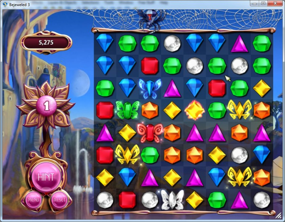 Butterflies mode: The blue butterfly is in greatest danger of being eaten, and the spider is poised ready above it. However, it can be rescued by swapping the blue gem in column 1, row 2 with the green gem below to form a match of 3 blue gems.