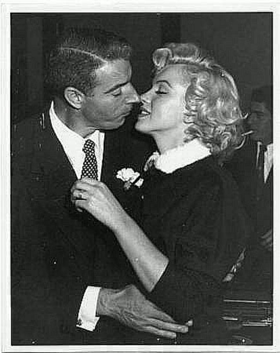 Marilyn Monroe and Joe DiMaggio marry in 1954.