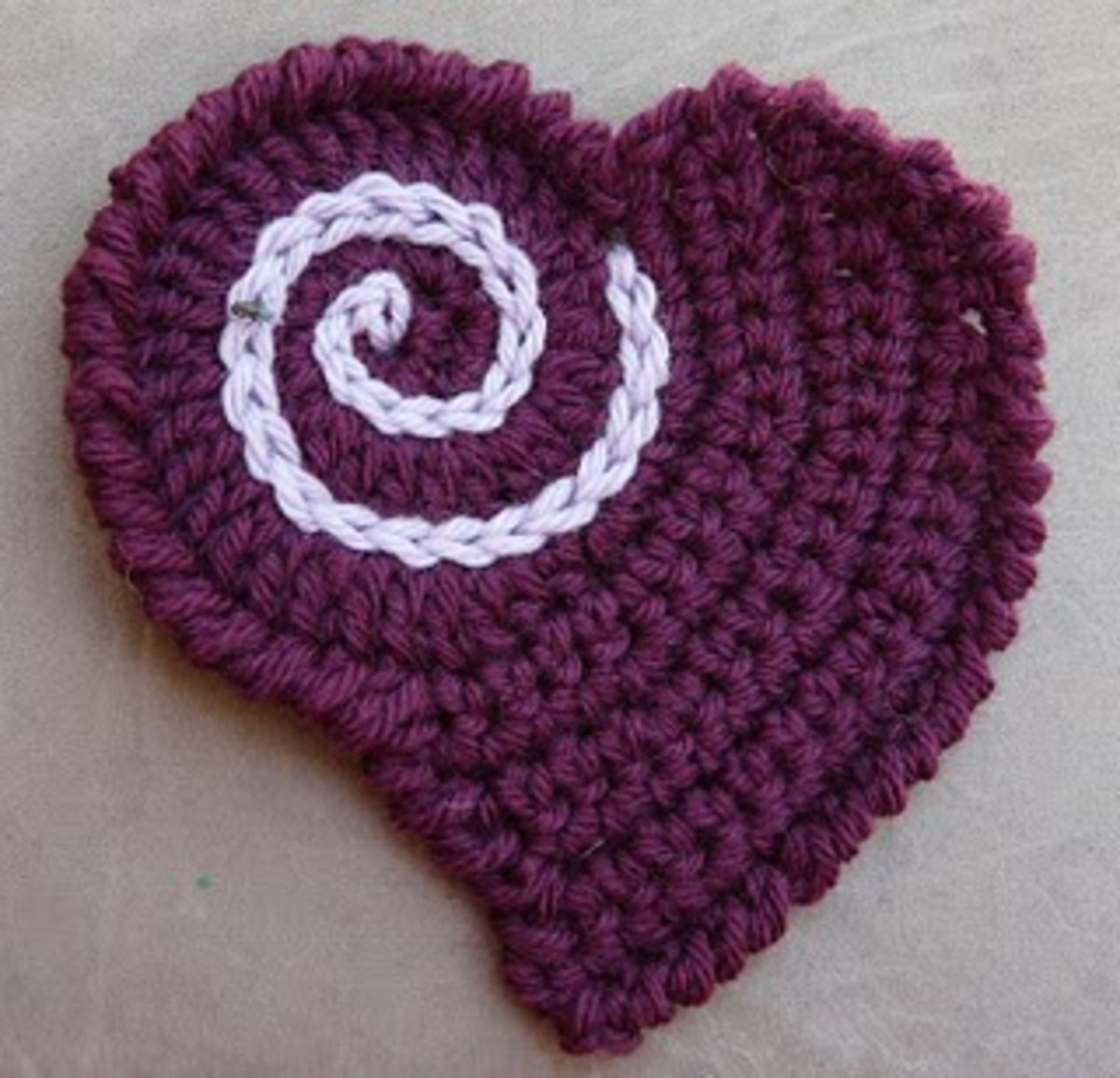 Crab Stitch Edged Heart by Julie -  This heart is part of free pattern from Caron called TEEN THROW taken from Twisted Strands Blog