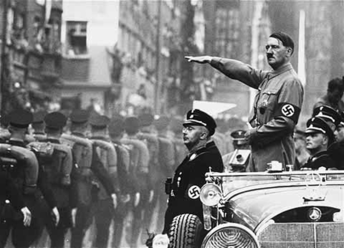 Adolf Hitler and Heinrich Himmler review SS troops during a Reichsparteitag (Reich Party Day) parade in Nuremberg.