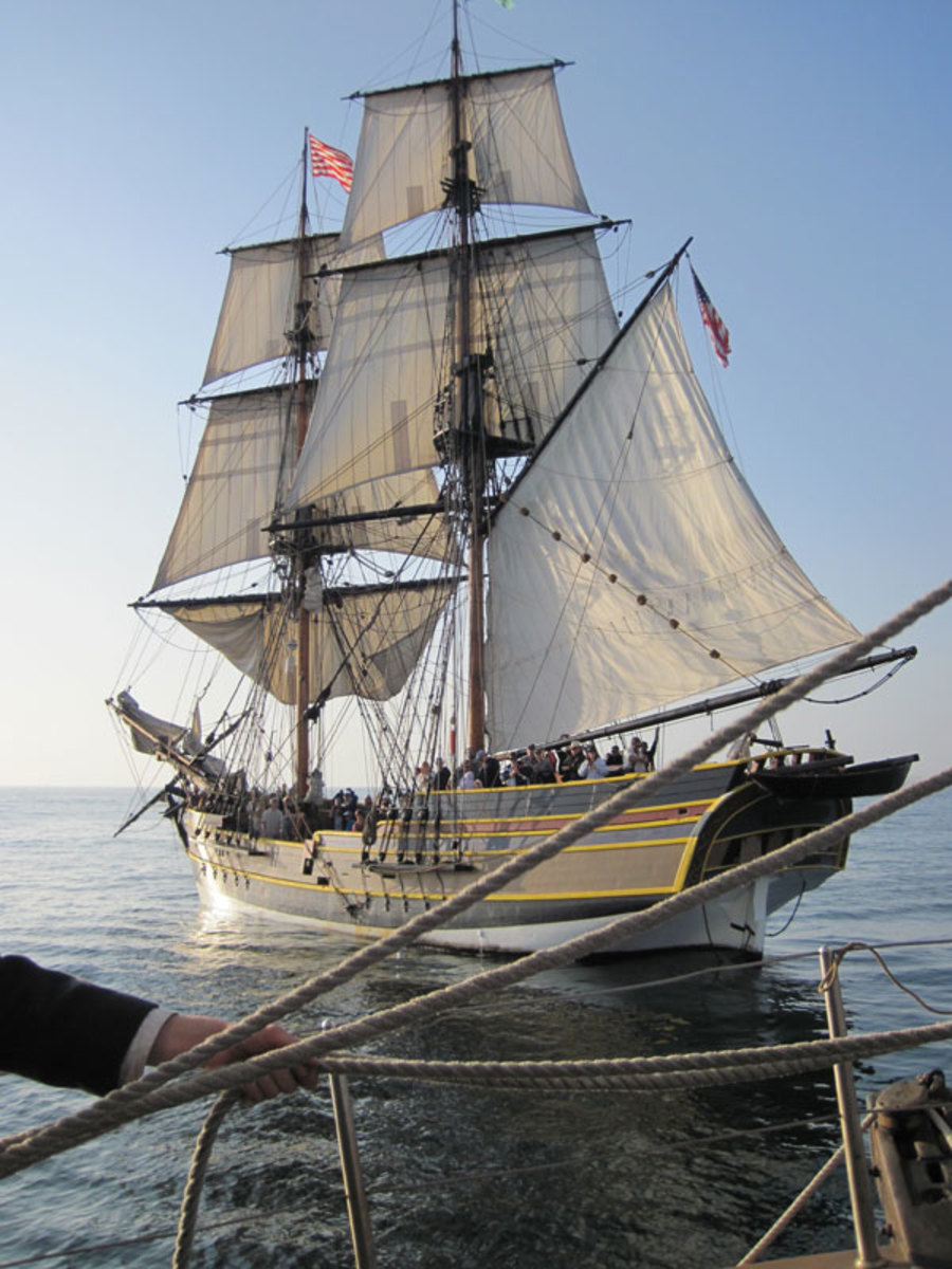 Note a crew member hauling on ropes in the foreground. Both ships' crews were constantly adjusting the sails to catch the wind as they turned about one another.