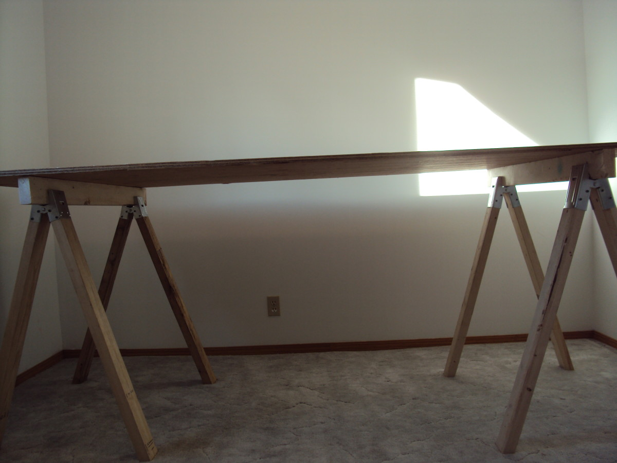 8' x 4' plywood sheet set atop two sawhorses.