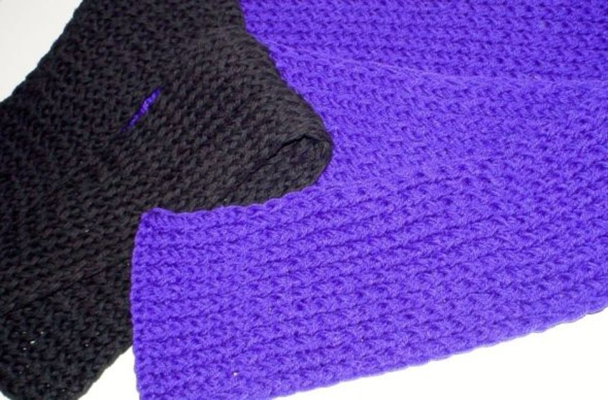 Black and purple scarves done with 2 strands of worsted weight yarn for heavy winter scarves.